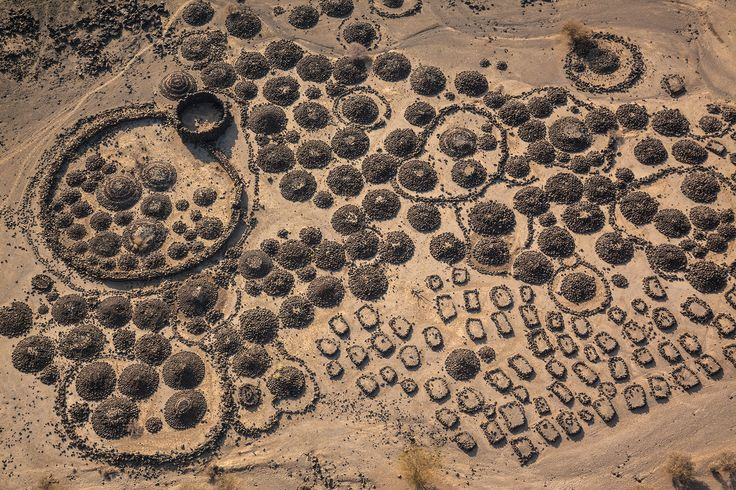 'Cemeteries and camps of Afari nomads sit amidst lava flows partially buried in clay near the Awash River Delta in Ethiopia.'