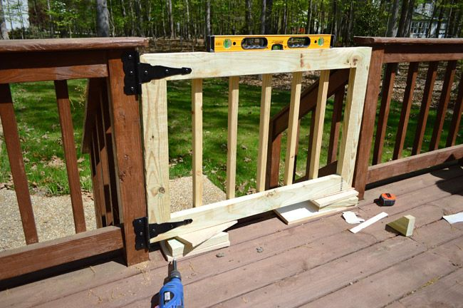 Build a more permanent gate to keep our dogs on deck (and kids too!)  Young House Love | Deckgate | http://www.younghouselove.com