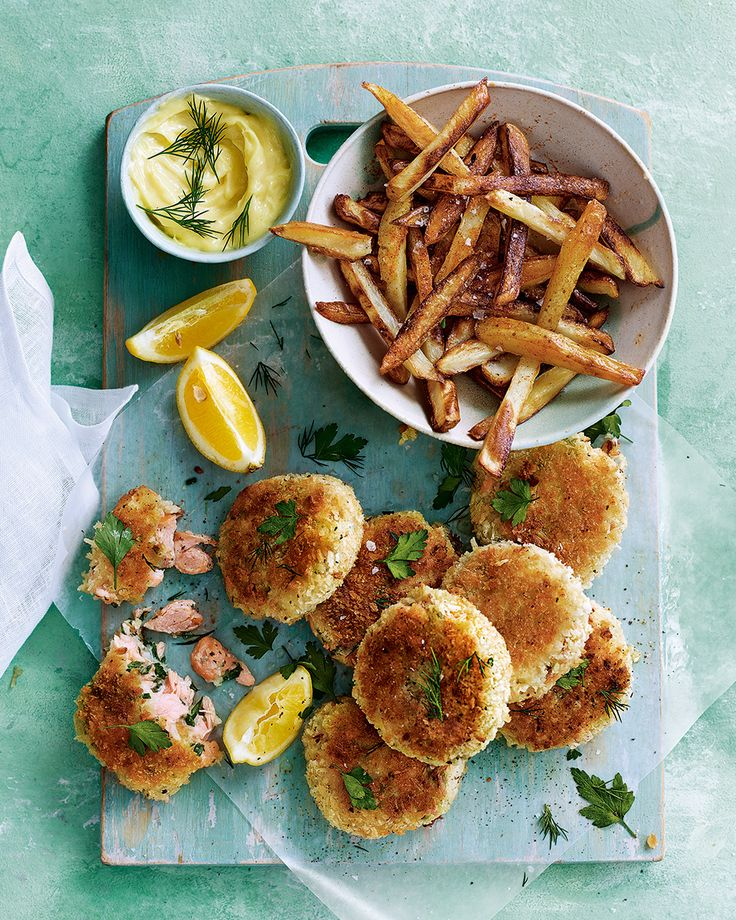 Forget fish and chips, we're all about these easy hot-smoked salmon fishcakes served with a zingy mayo and chunky homemade chips – perfect for a warm summer evening.