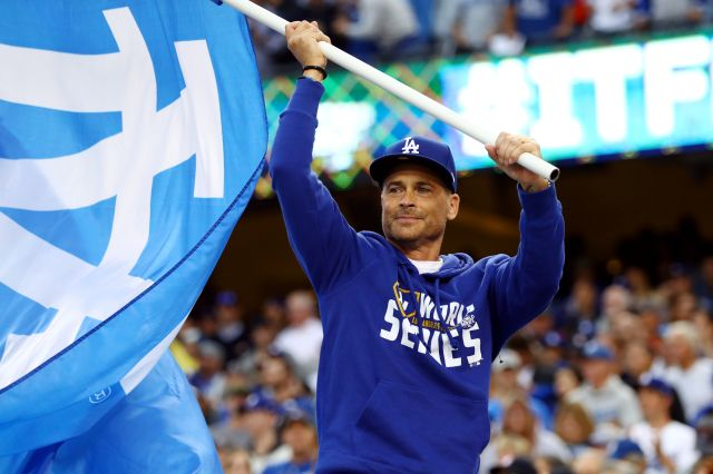 October 31, 2017:    World Series Game 6.   L.A. evens series at 3 games apiece with 3-1 win.    Actor Rob Lowe waves a Dodgers flag on the dugout prior to Game 6 of the 2017 World Series between the Houston Astros and the Los Angeles Dodgers at Dodger Stadium on Tuesday, October 31, 2017 in Los Angeles, California. (Photo by Alex Trautwig/MLB Photos via Getty Images)