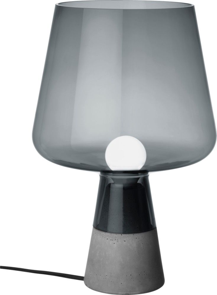 Iittala - Leimu lighting piece combines a strong concrete base and an impressive glass lamp portion. It comes in two sizes.
