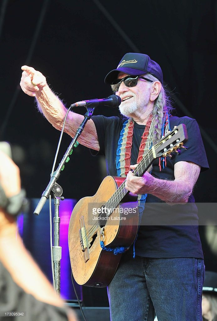 Singer Willie Nelson performs during the Oklahoma Twister Relief Concert to benefit United Way of Central Oklahoma May Tornadoes Relief Fund at Gaylord Family Oklahoma Memorial Stadium on July 6, 2013 in Norman, Oklahoma. To donate go to www.unitedwayokc.org or text REBUILD to 52000.