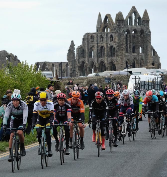 Riders competing in stage three of the Tour de Yorkshire ride past Whitby Abbey on May 1, 2016 in Whitby, England.