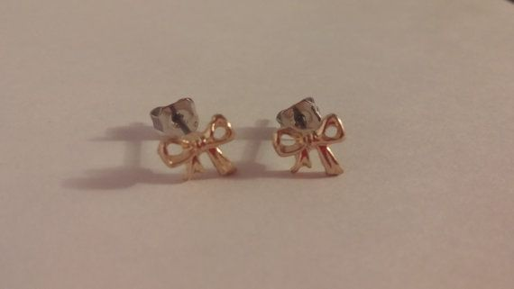 Check out this item in my Etsy shop https://www.etsy.com/ca/listing/459100780/gold-bow-studs