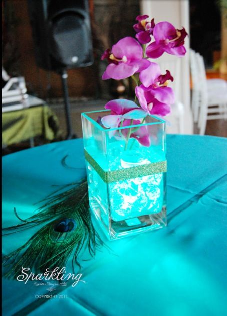 Purple and teal wedding centerpiece, i like the silver glitter band around the middle, totally easy to DIY