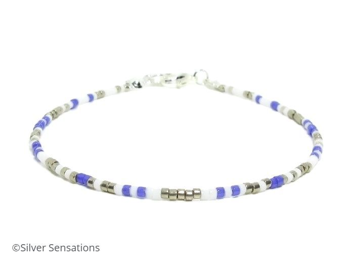 Purple White & Silver Skinny Bracelet @eshopsUK @UKhour #fashion #Craftbuzz https://www.silver-sensations.co.uk/slim-purple-white--silver-seed-bead-friendship-bracelet-8160-p.asp