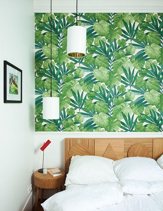 Geometric headboard and graphic wallpaper bedroom
