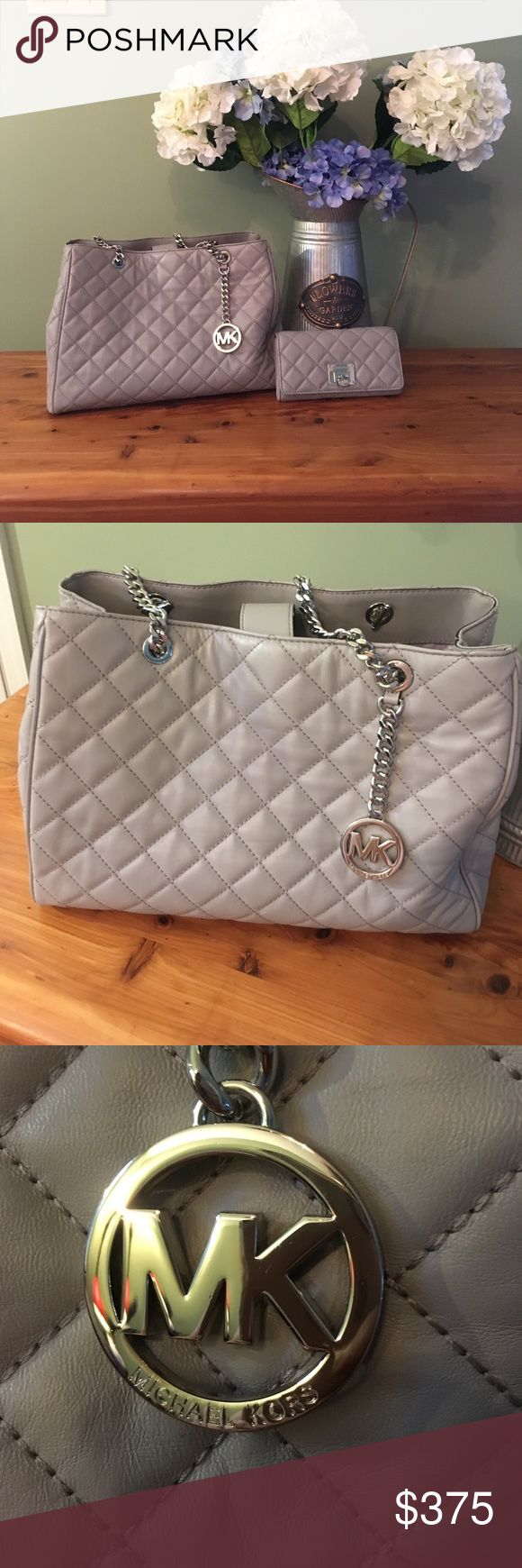Michael Kors quilted leather large tote & wallet Michael Kors quilted leather Susannah Large tote bag in pearl gray & Astrid carryall clutch quilted pearl gray. These items were purchased in April 2017 & I changed my mind.  Only used a handful of times and was protected with Michael Kors leather cleaner & conditioner & protect solution.  Like brand new condition.Large tote has beautiful silver chain details & soft quilted leather.It has a zippered middle compartment & tons of other storage…