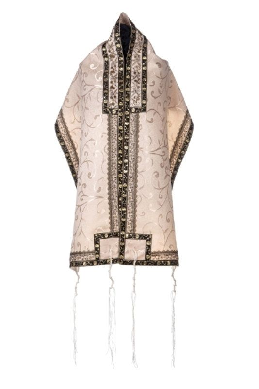 This impressive and original Tallit Set by Israeli artist Yafa Segev is handmade from the finest quality material & is decorated with