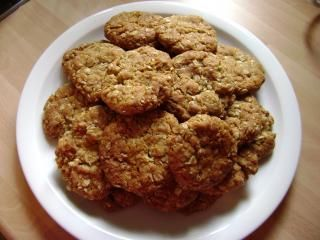 Anzac Biscuits - chewy Ingredients    1 cup plain flour  1 cup rolled oats  1 cup dessicated coconut  3/4 cup brown sugar  125g butter  2 tbs golden syrup  1 tsp bicarbonate of soda