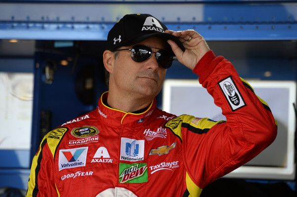 Jeff Gordon, driver of the #88 Axalta Chevrolet, stands in the garage area during practice for the NASCAR Sprint Cup Series Federated Auto Parts 400 at Richmond International Raceway on September 9, 2016 in Richmond, Virginia.