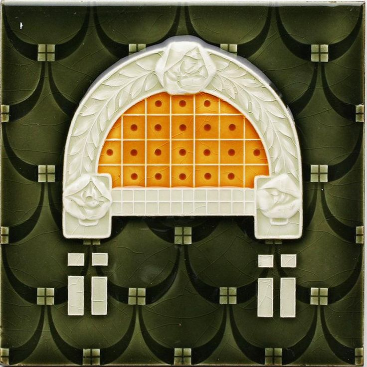 An Art Nouveau low relief tile with stylised rose window arch, dot grid, and cascade loops design in burnt orange...