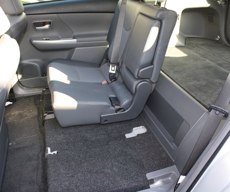 The rear seats in the 2012 Toyota Prius V slide, recline, fold flat, and, if…