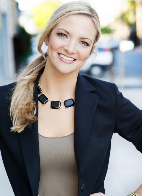 Model Julie Hamm. A low, loose pony is a great look that's not too harsh, yet is still formal. Her necklace also adds a nice touch without being too overpowering.