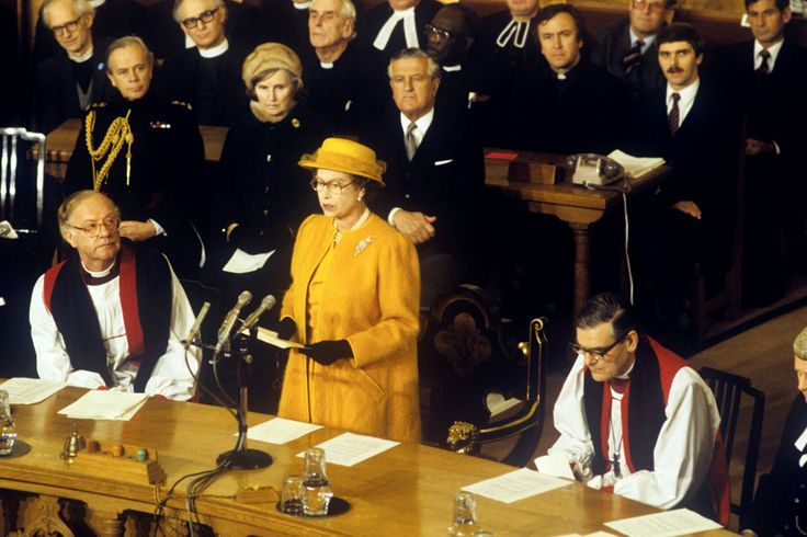 Vision In Mustard: November 1985, Queen Elizabeth II, watched by the Archbishop of Canterbury, Dr Robert Runcie (L), and Dr John Habgood, Archbishop of York (R), addressing the General Synod of the Church of England at Church House in Westminster