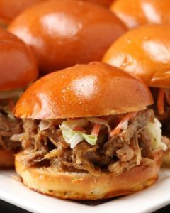 Honey garlic pork sliders, for the win. Pulled pork cooked low and slow topped with homemade coleslaw makes for the perfect combination.