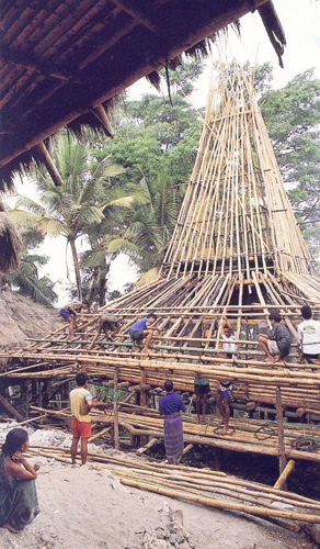 The construction of a 'high hat' roof of a traditional house in Tarung, Sumba…