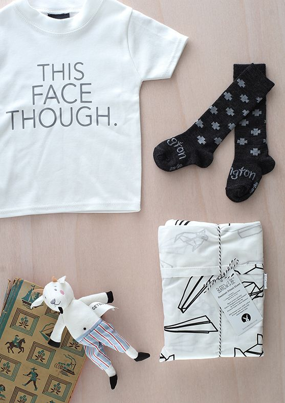 For your little ones   New Dapper Mr Bear range featuring 'This Face Though' tee. Printed socks and Burrow and Be fitted sheets from Bundle store & small bearded Goat toy found at Nordic Chill.  #kidsfashion #design #homewares #thecolombo #newzealand #flatlay