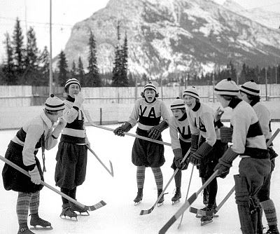 The Vancouver Amazons enjoy a light-hearted practice on the outdoor rink at Banff, Alta. Credit: Whyte Museum of the Canadian Rockies, V263-3862.