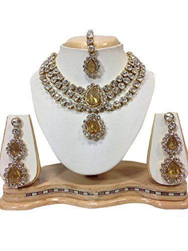 Indian Bollywood Elegant Yellow Gold Plated Party Wear Ne... https://www.amazon.com/dp/B01N12JA75/ref=cm_sw_r_pi_dp_x_3jXazb44NRVJ7