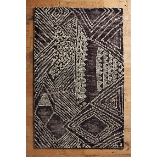Anthropologie Geo Megali Rug ($78) via Polyvore featuring home, rugs, dark grey, dark grey rug, charcoal grey area rug, dark grey area rug, geometric pattern rug and charcoal grey rug