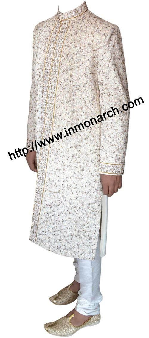 Elegant designer cream color brocade wedding sherwani. Hand embroidered as shown. It has bottom as churidar pyjama made in white color dupion fabric. Dry clean only. Available instock standard size 40R only.