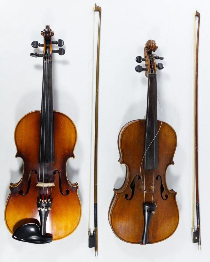 Lot 553: Antonius Stradivarius Copy Violin and Case; Together with a Guarnerius copy violin with attached paper label and case; both have bows
