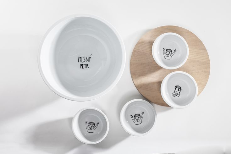 "The collection of porcelain bowls is inspired by the game Old Maid and appropriately named ""Choosy Maid"". The bowls are created in two sizes. The large set consists of a large bowl, four small bowls and a beech chopping board. The small set consists of a smaller bowl, two small bowls and a beech chopping board. The smooth side is used slicing. The inner side has groves, thanks to which the cutting board serves as a lid for the large bowl as well as holds the inserted small bowls in place…"