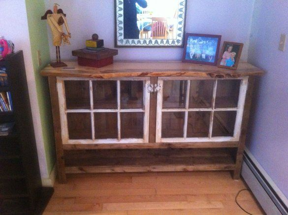 Reclaimed wood sideboard with recycled windows.