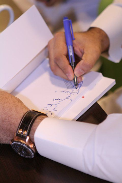 """This picture represents a lovely moment of my future : """"signing my first book """" . One of my dreams is to write more than 10 books about the secret of the life , our secret , and other useful topics."""