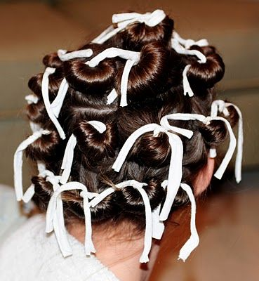Rag Culers to achieve the spiral curls...easy to do....and looks less painful than using rollers and sleeping on them all night... :) winner!