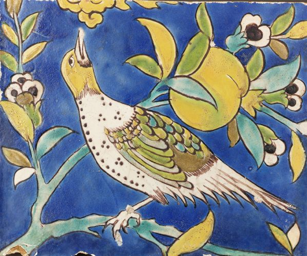 Bird on a Pomegranate Branch  17th century    Safavid period     Tile; stonepaste body painted with glaze  H: 20.6 W: 25.1 D: 3.3 cm   Iran