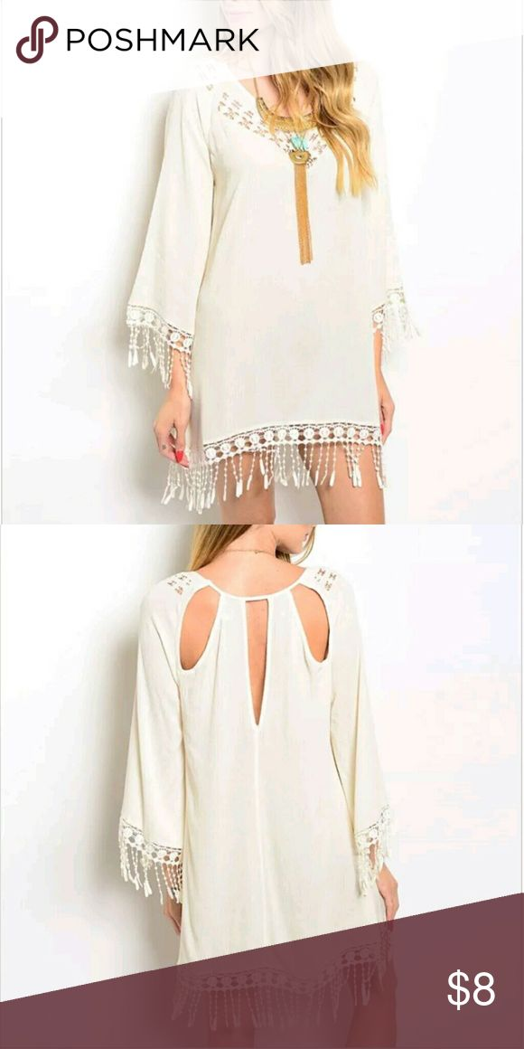 """CREAM CROCHET OPEN BACK FRINGE DRESS BOHO FESTIVAL THE CLOTHING COMPANY WOMEN'S LONG SLEEVE CREAM TASSLE SHIFT DRESS  SIZE L NEW WITH TAGS MEASUREMENTS: 33 1/4 """" LONG (INCLUDING TASSLES) 43"""" BUST   Ships in 1-2 business days message me if you have any questions. check out my other listings! Dresses Long Sleeve"""