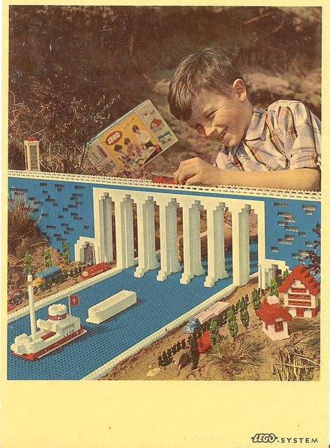 Early advertising showing both the possibilities & limitations of building with such a limited variety of bricks. Note the early packaging just to the left of the boy's head.
