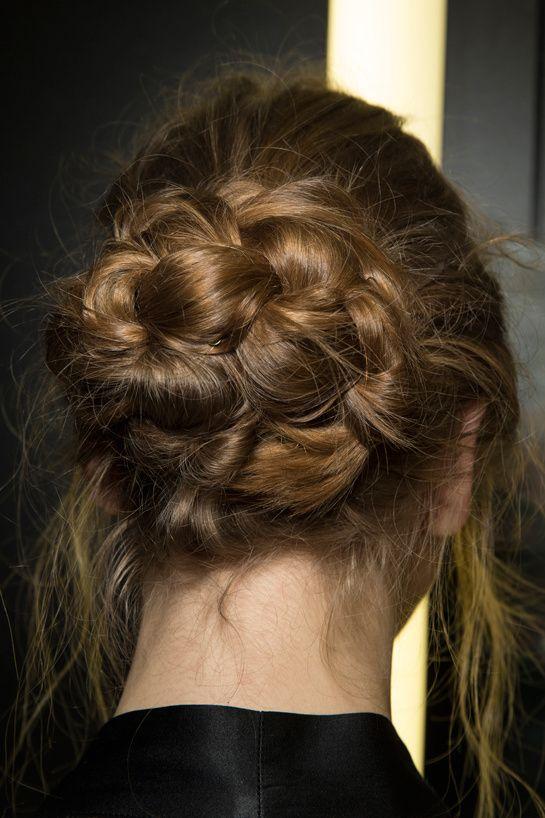 That braided bun looks familiar...Backstage Dolce & Gabbana Automne-Hiver 2014-2015: http://www.vogue.fr/mariage/beaute/diaporama/une-tresse-speciale-jour-j/18219/image/991430