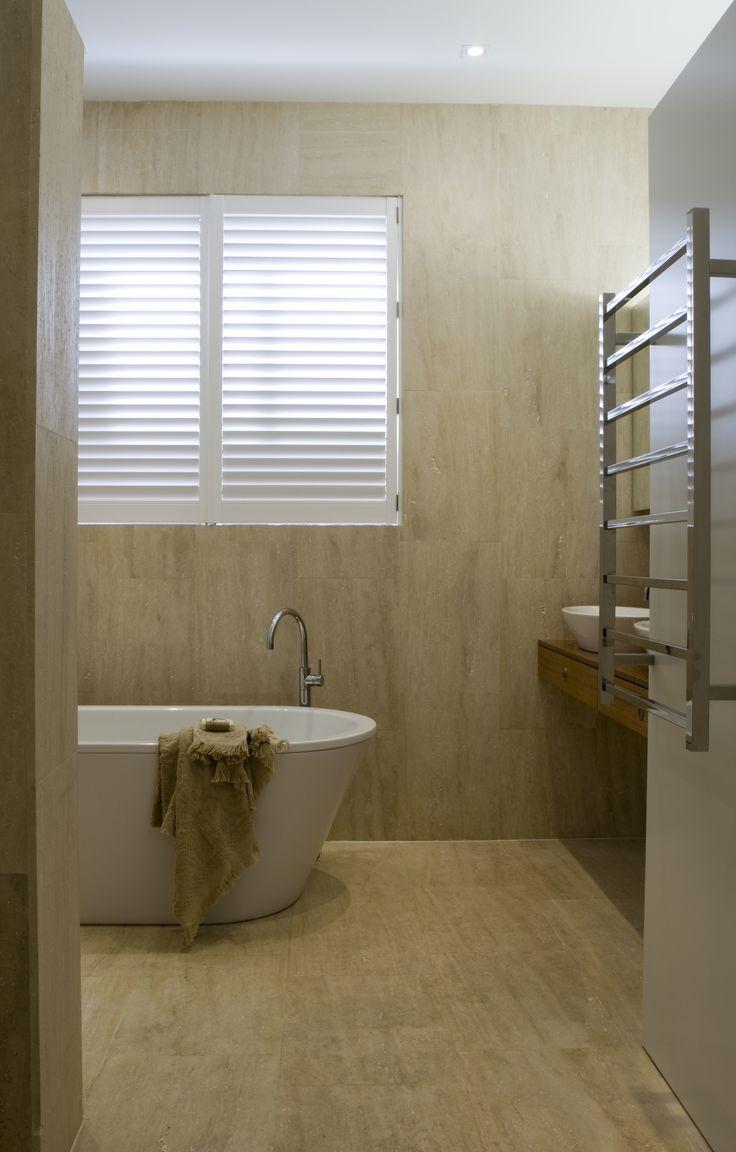 Travertine tiled Bathroom with kaldewei freestanding bath. Brooke Aitken Design.