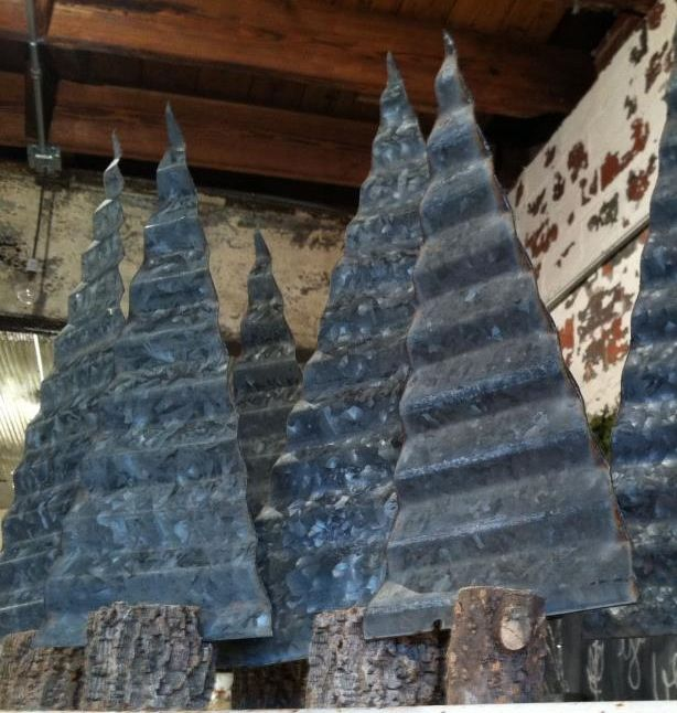 love these rustic christmas treesmade from corrugated metal tree branch pieces