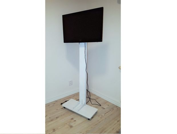 Floor model TV Stand on wheels
