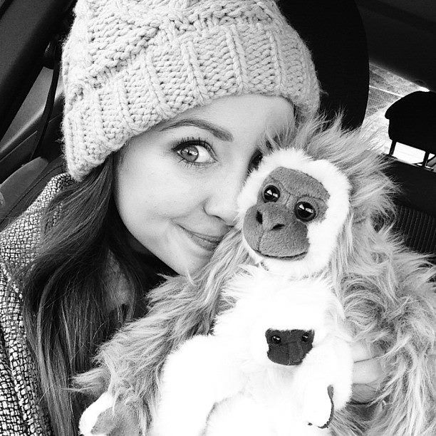 Zoella with the cutes cuddly toy!!  Monkeys!!
