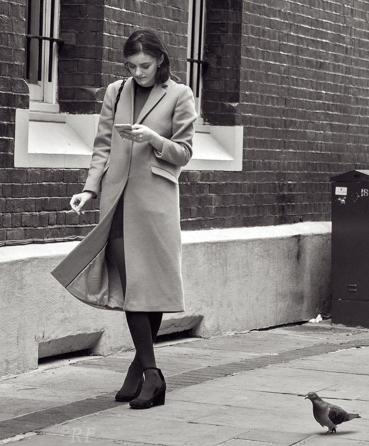 Girl on phone, near Kensington High Street. By Richard Farland.