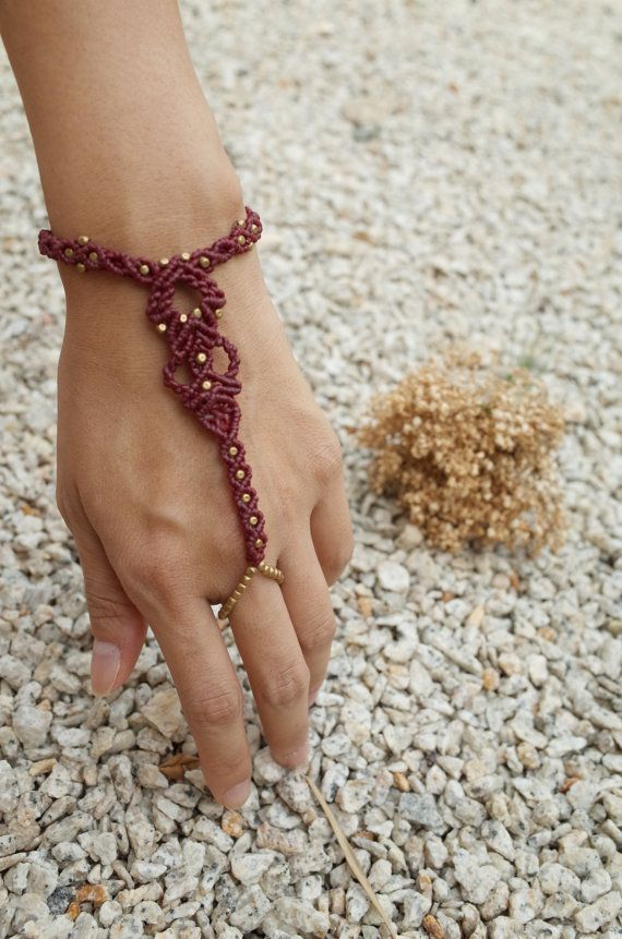 Macrame Slave Bracelet with beads One of a kind macrame jewelry made with love  Materials: -Wax cord in dark red color -Beads  Measurements: Adjustable wrist length: 13cm - 24cm  Ships worldwide from Malaysia  You can also contact me at: cthesoulofmoon [!at] gmail.com