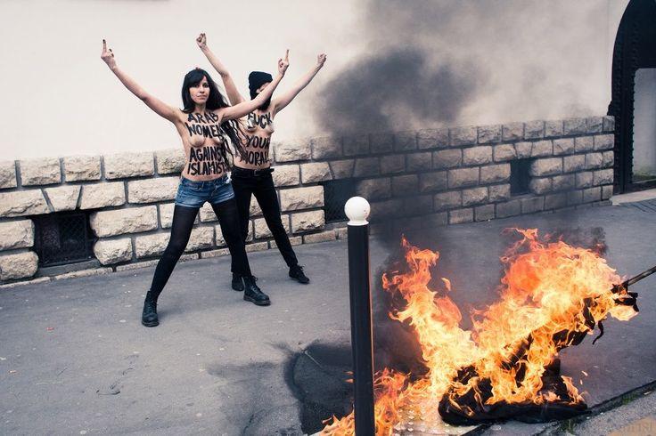 Topless Lebanese girls burn an ISIS flag #SerusDuhbiznatch