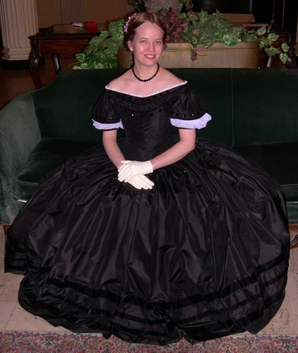 Black morning dress with ball top.