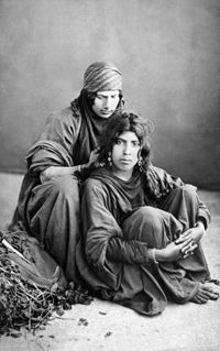 Tancrède R. Dumas: Two Young Bedouin Women, Jericho c.1860 - On is sitting, her hair being groomed by her companion behind her. http://www.aldinefineart.com/tancrede-r-dumas-two-young-bedouin-women-jericho-c-1860/