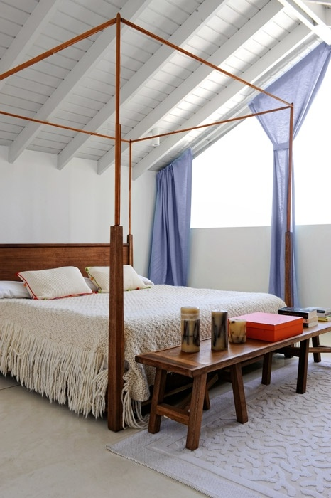 Master bedroom: the bed and bench are from Buenos Aires designer Eugenio Aguirre. The bed's wool cover was made by a local woman in Punta del Este.
