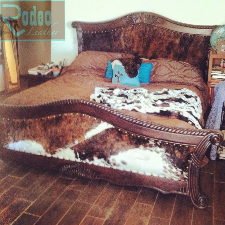 $60 Goodwill cracked wooden bed. I upholstered with padded cowhide headboard and footboard to make it Oh Soo Pretty! :D check out Rodeo Leather for other pretties.