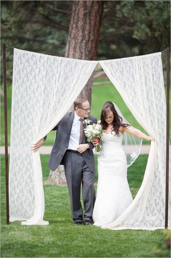 bride entering through lace curtain with dad #fatherdaughter #downtheaisle #weddingchicks http://www.weddingchicks.com/2013/12/18/colorado-wedding/
