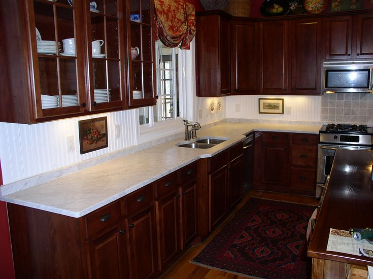 Pretty cherry cabinets white bead board back splash for Cherry and white kitchen cabinets