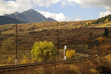 Railroad in Liptov region of Slovakia during autumn. In the distance can be seen peak of Choc mountain.