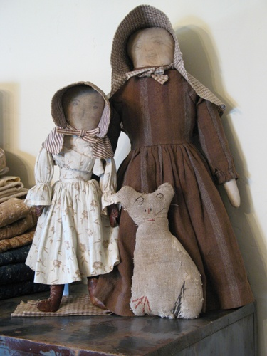 early dolls and cat - photo by Jill Peterson  I think Imused to own the large doll in brown striped wool dress!
